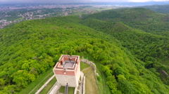 Aerial view of Medvedgrad tower with forest around it and cityscape in distance. Stock Footage
