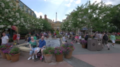 Relaxing near the fountain at Disney World, Orlando Stock Footage