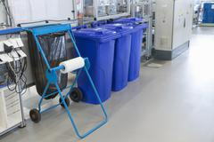 Sorting of waste into the bins in the assembly factory Stock Photos