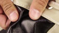 Human hand testing natural leather, part of backpack Stock Footage