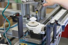 Assembly line of plastic components - stock photo