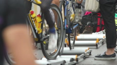 Cyclists warm up prior Stock Footage
