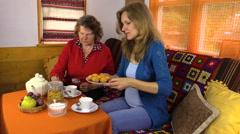 Afternoon with tea cakes grandma and woman together in room Stock Footage