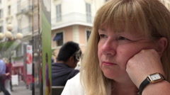 Sad and upset senior woman alone in cafe Stock Footage