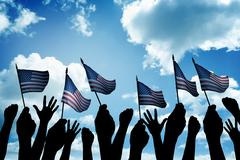 Group of people waving small USA flag Stock Photos