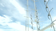 View of masts of sailing boats docked in Porto Cervo Stock Footage