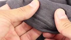 human hand testing gray synthetic thermal underwear, closeup(macro) - stock footage