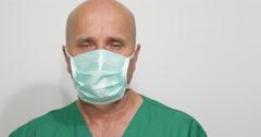 Medical Man Surgery Wearing Face Mask Bacterial Protection Closeup Pan Left Shot Stock Footage