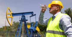 Oil Pumps Field Torrid Summer Hot Day Sweat Worker Thirsted Drink Water Bottle Stock Footage