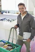 Worker with delivery in kitchen - stock photo