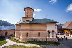 Tourists visiting the old orthodox monastery from Polovragi - stock photo