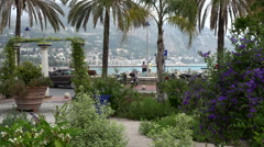 People stroll along the promenade waterfront at Menton, France Stock Footage