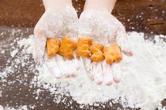 Biscuit cookies alphabet word FRESH on kid hands Stock Photos