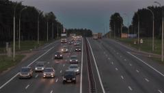 Road vehicles daily traffic. View from overpass bridge to multiple lane highway Stock Footage