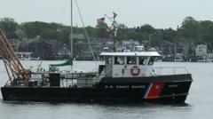 U.S. coast guard boat navigates in Newport Stock Footage