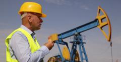 US Oil Pump Gas Industrial Rig Platform Field Worker Man Eating Lunch Time Break Stock Footage