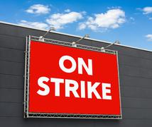 On strike written on a billboard - stock photo