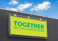 Together we can achieve more written on a billboard - stock photo
