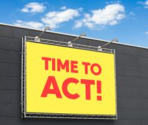 Time to act written on a billboard Stock Photos