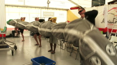 Sailors carry sail during Volvo Ocean Race preparation Stock Footage