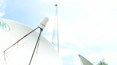 Camera Panning down from tower into satellite dishes Stock Footage