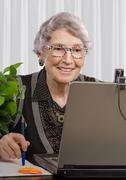 Cheerful experienced coach teleworking - stock photo