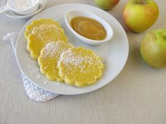 Oven baked gluten-free maize pancakes with applesauce - stock photo