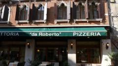 Ancient Venetian architecture. Pizzeria. Vertical movement of the camera. Stock Footage