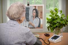 Patient under the telehealth supervision Stock Photos