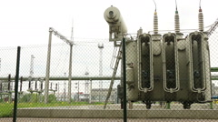 Industrial high voltage substation power transformer power plant teritory foo Stock Footage