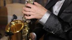 Enjoying saxophone 01 Stock Footage