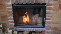 Beautifully lit fireplace Stock Footage