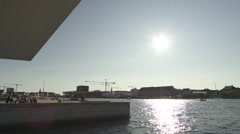 Pan of Copenhagen Opera and roof Stock Footage