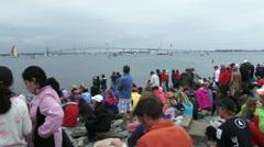 People attend Volvo Ocean Race in port race in Newport bay - stock footage