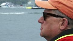 Stock Video Footage of Man attends Volvo Ocean Race in port race in Newport bay