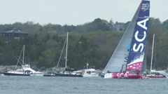 Stock Video Footage of Volvo Ocean Race boats navigate in Newport bay during in port race
