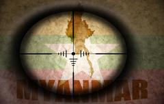 Sniper scope aimed at the vintage myanmar flag and map Stock Illustration