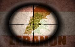 Sniper scope aimed at the vintage lebanon flag and map Stock Illustration