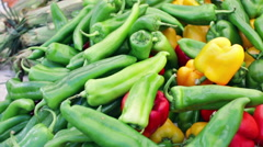 Variety of fresh organic peppers on the table at the local farmer's market. Stock Footage