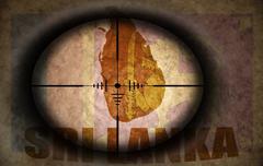 Sniper scope aimed at the vintage sri lanka flag and map Stock Illustration