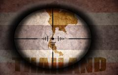 Stock Illustration of sniper scope aimed at the vintage thailand flag and map