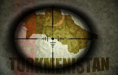 Sniper scope aimed at the vintage turkmenistan flag and map Stock Illustration