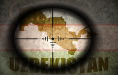 Stock Illustration of sniper scope aimed at the vintage uzbekistan flag and map