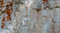 Rock pisanitsa. Pictures of ancient man, the Urals, Russia. 1280x720 Stock Footage