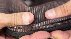 human hand testing synthetic material, outside and inside of bag - stock footage