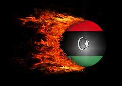 Stock Illustration of Flag with a trail of fire - Libya