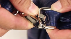 human hand open clasp on the shoulder strap, closeup(macro) - stock footage