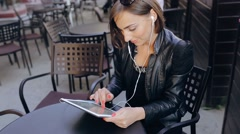 Beautiful young woman uses phone Stock Footage