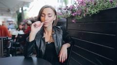 Young beautiful woman enjoying the e-cigarette Stock Footage