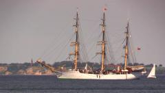 Sailboats passing a training tall ship anchored in the Sound Stock Footage